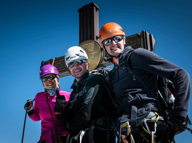 Am Gipfel Des Grossglockner Mit Bergfuehrer